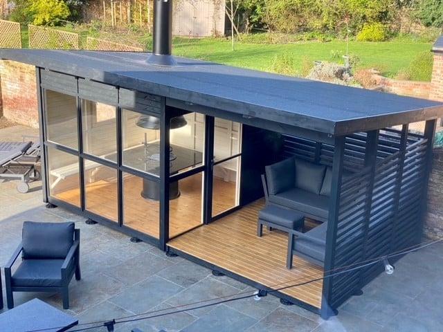 Customer photos of a newly built Elias BBQ cabin with veranda